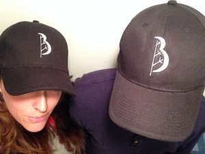 Couple wearing Baum Tree care hats
